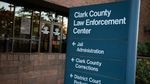 """A sign reads """"Clark County Law Enforcement Center."""" Arrows underneath direct people towards jail administration, Clark County Corrections, and district court probation services."""