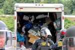 Federal officials were seen loading materials used to blockade the entrance to the Portland ICE building into a U-Haul truck Thursday, June 28, 2018, as they worked to reopen the entryway.