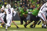 Oregon running back CJ Verdell (7) runs through hole in during the fourth quarter of an NCAA college football game Saturday, Sept. 25, 2021, in Eugene, Ore.