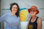 Laura Glazer and Jennifer JJ Jones stand next to their poster for the Agnes Varda Forever Festival being held at the Clinton Street Theater from Aug 19th - 31st.