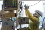 Aug. 19, 2021: Karla Mayorga, RN, tends to a patient. Every person who was in this intensive care unit at Oregon Health and Science University in Portland was critically ill with COVID-19.