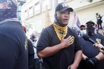 """Tusitala """"Tiny"""" Toese speaks at dueling demonstrations gather in downtown Portland, Ore., Saturday, Aug. 22, 2020. Groups like Proud Boys and Patriot Prayer showed up downtown to oppose monthslong demonstrations against systemic racism and police brutality."""