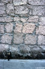 These bricks, found in downtown Bend, weren't molded: they were quarried from Tumalo tuff. The chisel marks from the people who mined them are still present.