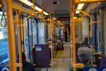 A TriMet Yellow Line MAX train car is mostly empty as it makes its way through downtown Portland, Ore., on Friday, March 20, 2020. TriMet's ridership numbers have decreased significantly as the region deals with the ongoing coronavirus outbreak.