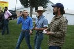 Parker hands out copies of the U.S. Constitution as he campaigns at the Gooding Pro Rodeo.