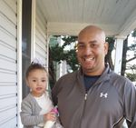 Jason Washington was killed by Portland State University police in 2018. Here, he holds his granddaughter, Kailee.
