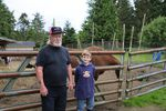 Goat farmer Jerry Busenius and his nine-year-old apprentice and grandson, Sam Hoffman.