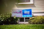 A house displays signs for Canda Avalos, a Portland City Council candidate, and Teressa Raiford, a Portland mayoral candidate, in the front yard in the Southeast Portland neighborhood of Brooklyn on Monday, April 20, 2020.