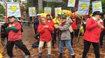 "Protesters danced to their own version of ""YMCA"" in which they asked PGE why the utility is considering natural gas when wind and solar energy would be better for the planet."