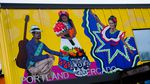 A mural representing Latino culture adorns the exterior wall above the main entrance to the Portland Mercado in SE Portland, Ore., on Wednesday, May 20, 2020. The Portland Mercado, opened in 2015, serves as an incubator for Latino-owned and operated small businesses, especially restaurants and food carts.