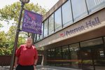 Associate dean of nursing Paul Smith stands outside Peterson Hall on the Linfield College nursing campus in Portland, Ore., Tuesday, Aug. 6, 2019. Linfield purchased a 10-building campus in Portland to host its nursing program.
