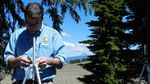 Chris Wayne adjusts a microphone stand. Scientists at Crater Lake National Park have recorded natural sound for a month at a time at 20 locations in the park.