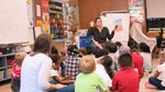 """Alder Elementary School teacher Katie Metko follows up a game of """"Simon Says"""" by reading a fable to her kindergarten class."""