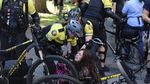 Portland Police arrest a young woman at a protest on Sept. 10, 2017.