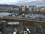 In this aerial photo taken with a drone, homeless camps are seen in a vacant parking lot on the central eastside in Portland, Ore., Tuesday, Dec. 8, 2020.