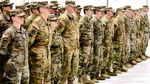 Oregon Army National Guard Soldiers with Company G, 1st Battalion, 189th Aviation Regiment, stand in formation during a demobilization ceremony honoring their return from overseas deployment, March 4, 2018 in Salem, Oregon.