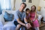 """Stathis Tsamouras, left, with his daughter Konstantina, and wife, Madison Brown. Tsamouras grew up in Limni and remembers fleeing a massive fire in 1977, when he was 10. """"This summer we faced a fire much larger and more apocalyptic than ever before,"""" he says."""