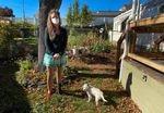 Misty Muñoz stands in front of her garden at Medford Estates on October 14, 2020. Muñoz says she doesn't feel safe living amid dozens of destroyed mobile homes.