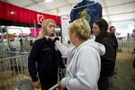 Ceanna Bergstrom fixes the collar on her daughter Erika's shirt before the market hog competition at the Clackamas County Fair. FFA competitors are not only judged by their animals, but also their personal appearance.