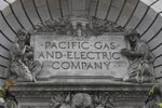In this April 16, 2020, file photo, a Pacific Gas & Electric sign is displayed on the exterior of a PG&E building in San Francisco.