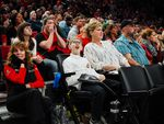 Fans react to a play during a regular season game between the Portland Trail Blazers and the Brooklyn Nets at the Moda Center in Portland, Ore., Friday, March 25, 2019.
