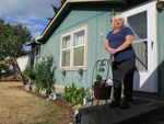 Sandra Lovingier, 57, bought her home in 2009. If the park closes, she said she'll need to walk away from the house. She plans to live either in a tent or in her car.
