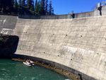 Biologists used a cataraft and a tangle net to catch bull trout at the base of Clear Creek Dam. They're trying to help the fish around the dam so that they can get to better habitat.