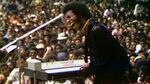 Sly Stone performs at the Harlem Cultural Festival in 1969, in a still from the film <em>Summer of Soul</em>.