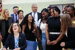 Oregon Gov. Kate Brown laughs with Jefferson High School students as she ceremonially signs the Student Success Act in Portland, Ore., Wednesday, Aug. 28, 2019.