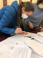 Kat Mostue signs adoption paperwork in China amid the coronavirus outbreak.