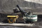 In this April 4, 2013, file photo, a mechanized shovel loads a haul truck with coal at the Spring Creek coal mine near Decker, Mont. The United States is out of the Paris climate agreement on the day after the 2020 presidential election. Experts say the outcome will determine to some degree just how hot and nasty the world will get in the future. The two presidential candidates have stark differences on fighting human-caused climate change.