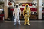 Emergency dispatchers in Portland will now try and ask callers about out-of-state travel, known exposure to the virus and any symptoms they may have. If the caller seems like they may have contracted COVID-19, firefighters might choose to wear either of the two protective suits, worn above by Kevin Leonard (left) and Bozeb Beckwith (right).