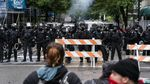 Portland police used tear gas and rubber bullets to disperse protesters from near the Justice Center an hour before the 8pm curfew went into effect on May 30, 2020. The protests were against racist violence and police brutality in the wake of the Minneapolis police killing of George Floyd.