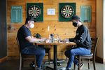 "Colin Rath, right, one of the owners of Migration Brewing, sits with operations  manager Brandon Mikel. Rath said he is frustrated Gov. Kate Brown may impose new dining restrictions. ""It's a whole lot of a guessing game,"" Rath said. ""Staff don't know what to plan on. Guests don't know what to plan on."""