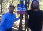 """William Fisher, left, of Salmon, Idaho, and Jamey Landin, of Burns, have pledged to guard the unofficial memorial for Robert """"LaVoy"""" Finicum until agencies agree to allow a permanent site."""