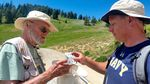 Robbin Thorp helps Brendan White identify a bumblebee on Mount Ashland.