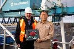 Port of Portland executive director Curtis Robinhold presents captain Kim Ex Soo with a celebratory plaque aboard the first SM Line vessel in Portland, Ore., on Tuesday, Jan. 14, 2020.