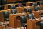 Empty chairs in a formal government chamber