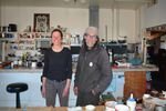 Rachel Christenson and Peter Wale live in the old Manitou Cafe with no electricity. They burn a wood stove for heat and charge a car battery with a small solar panel to power one light bulb and a laptop.