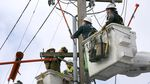 PGE contractors from DJ's Electrical in Portland repair a transformer box on a power pole on Southeast Madison Street near Southeast 17th Avenue in Portland, Feb. 16, 2021.
