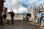 Dean Tucker, cow boss at the Pine Valley Ranch, left, and rancher Chad DelCurto talk wolves at Tucker's place in Richland, Oregon.