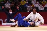 France's Clarisse Agbegnenou celebrates winning the judo women's 63kg gold medal bout against Slovenia's Tina Trstenjak  on July 27, 2021.