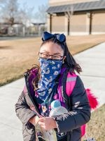 Gigi, 8, outside of school after limited in-person instruction in the Umatilla School District.