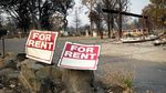 Rent signs near a mobile home park in Phoenix that was entirely destroyed by the Almeda Fire.
