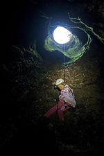 """Aspen rappels into a cave as a small girl. """"She's never really known a life that didn't include caving and research in the field with invertebrates,"""" her father says."""