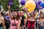 Portland Pride Parade-goers wave to the crowd Sunday, June 18, 2017.