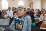 A Rohingya boy listens to Quranic lessons at Omar Farooq mosque on Dec. 2, 2018.