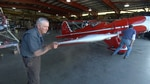 Volunteer Ron Wilkins helps roll a 1937 plane out of the restoration shop to test fire the engine.