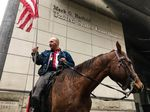 Duane Ehmer rides his horse Hellboy outside Darryl Thorn's sentencing hearing in downtown Portland, Nov. 21, 2017.