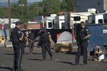 Bend police are shown during the operation to close Emerson Avenue in Bend on June 23, 2021.